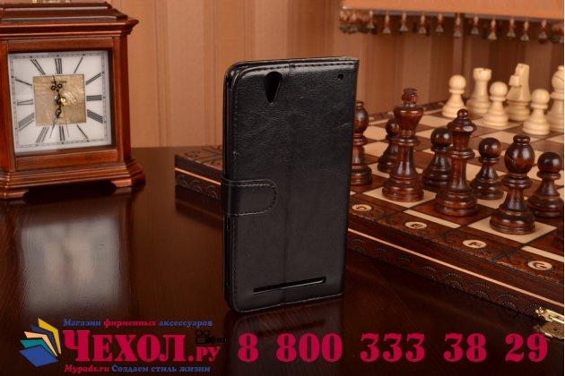 Чехол-книжка из качественной импортной кожи с подставкой застёжкой и визитницей для сони иксперия т2 ультра дуал черный